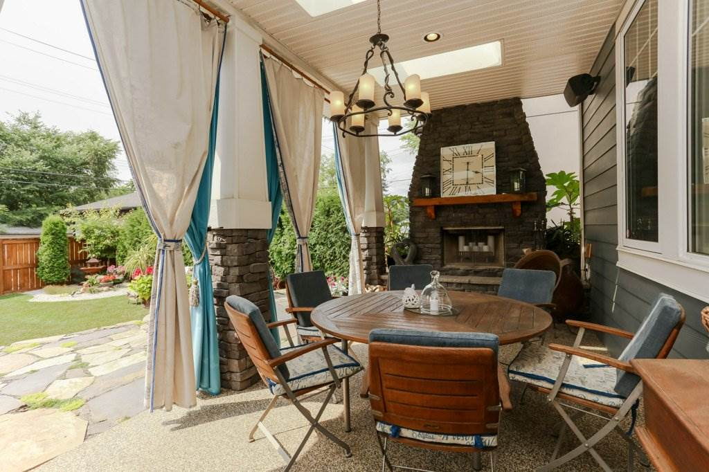 Covered patio with wood burning fireplace, out door speakers. Enjoy year round.