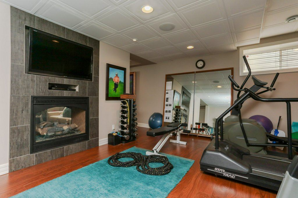 Presently being used as an exercise area watch TV & enjoy the double sided fireplace