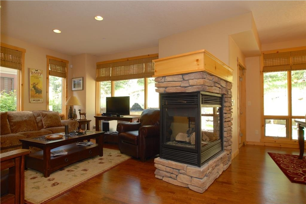 Open concept living area with 3-sided gas fireplace