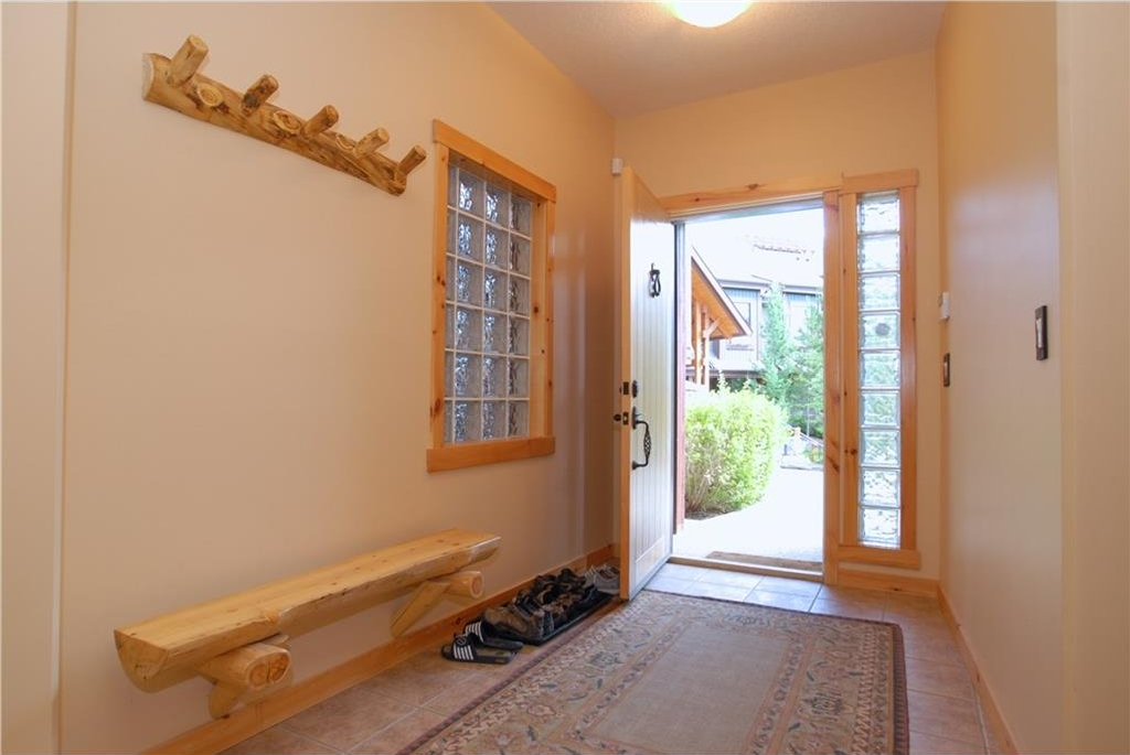 Front foyer with built-in log bench