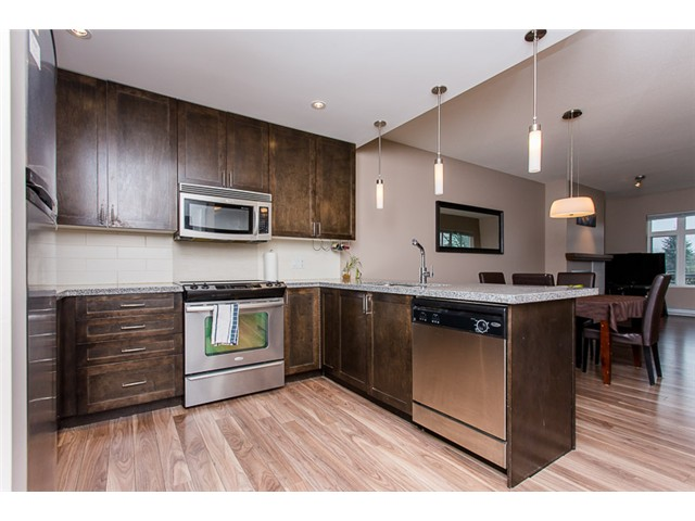 "Photo 1: 403 2368 MARPOLE Avenue in Port Coquitlam: Central Pt Coquitlam Condo for sale in ""RIVER ROCK LANDING"" : MLS(r) # V1101587"