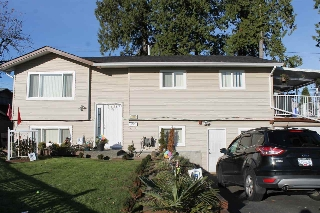 "Main Photo: 9582 132A Street in Surrey: Queen Mary Park Surrey House for sale in ""QUEEN MARY PARK"" : MLS(r) # R2017643"
