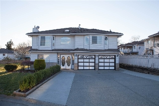 "Main Photo: 8579 148A Street in Surrey: Bear Creek Green Timbers House for sale in ""Bear Creek"" : MLS(r) # R2052245"