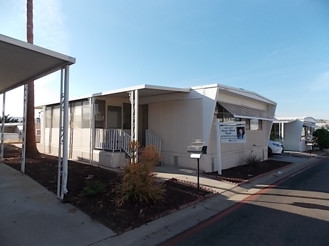 Main Photo: SANTEE Manufactured Home for sale : 2 bedrooms : 8301 MISSION GORGE RD #297
