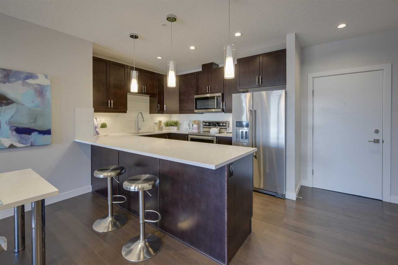 The unit is located on the 8th floor, 9 foot ceilings, large windows, hardwood flooring, dark maple cabinets, stainless appliances, quartz counters
