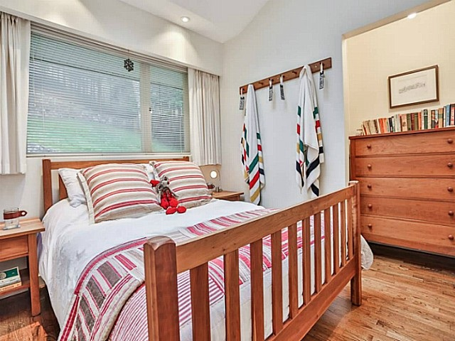 Delightful second bedroom has a skylight and vaulted ceiling.