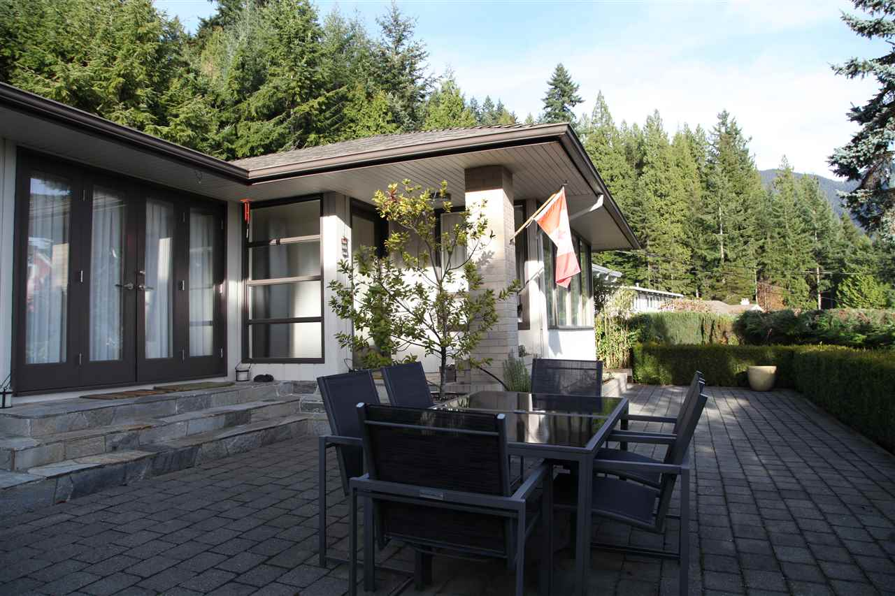 Large entertaining patio faces views of Grouse Mtn. all the way to UBC