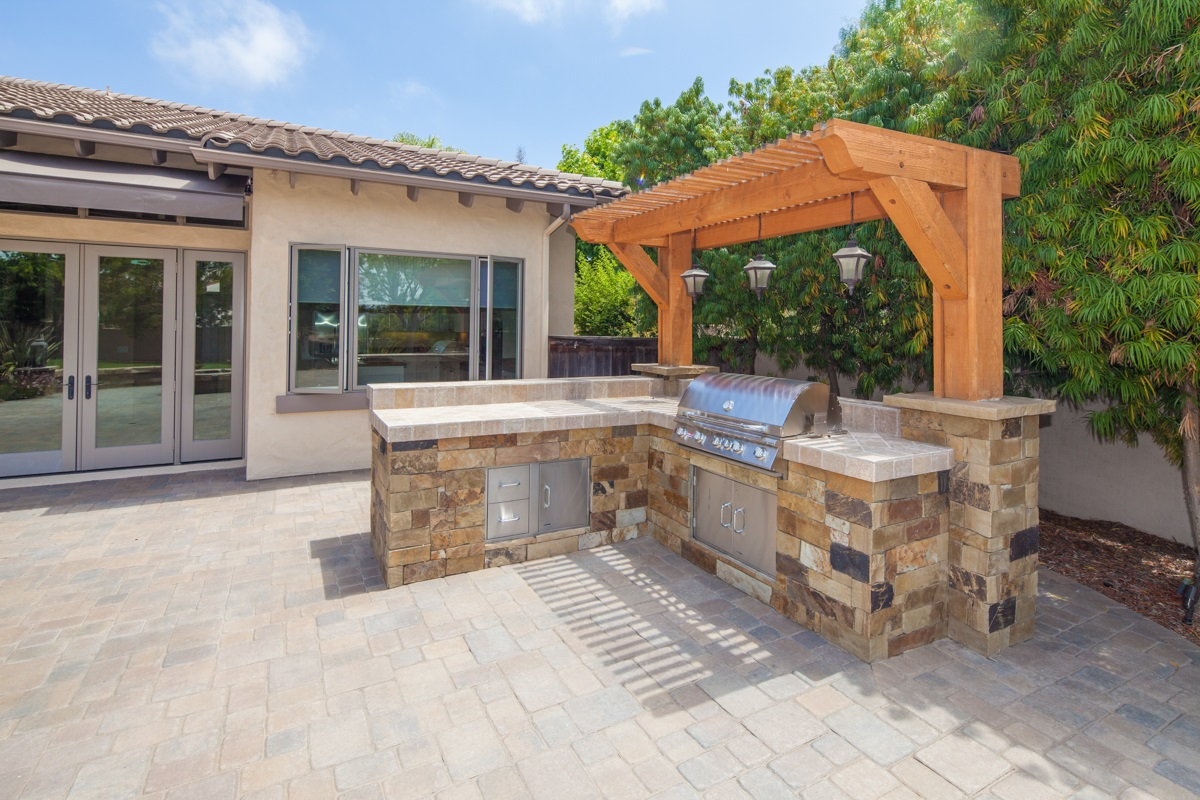 Built in outdoor kitchen area.
