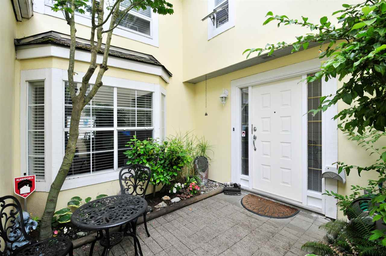 "Main Photo: 8469 PORTSIDE Court in Vancouver: Fraserview VE Townhouse for sale in ""RIVERSIDE TERRACE"" (Vancouver East)  : MLS® # R2190962"