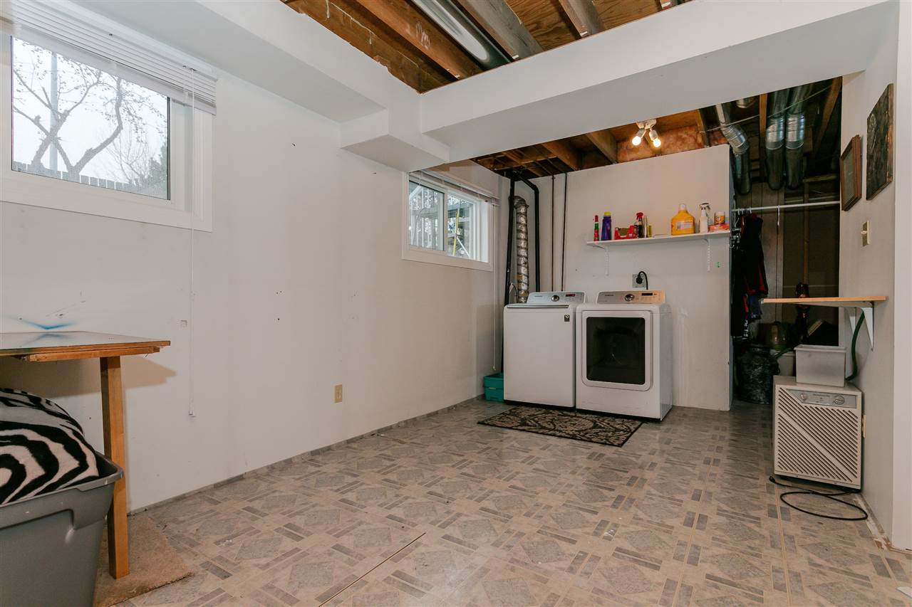 Finally a bright, spacious laundry room with new windows. You will never feel like you are in the basement again! You will love the room to move, storage, room to fold, access your sewing machine, hang dry clothes, paint or scrapbook in the sunshine.