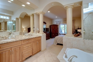 Your lavish ensuite features a large corner oval shaped jetted tub, separate tiled shower & dual sinks with granite tops.