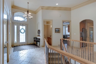 The entrance offers a large space to welcome your guests. Notice the newer designer front door.