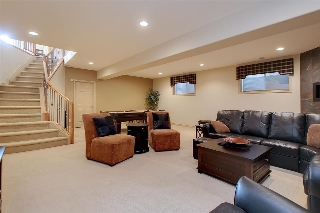 The family room is huge and boasts 3 oversized windows that allow loads of natural light to flood this space.
