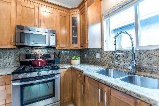Maple Cabinets, Granite Countertops, lots of storage and a window above the sink.