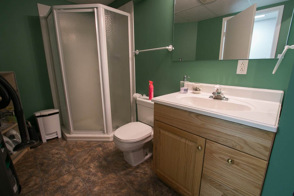 Basement 3 piece bathroom and laundry room.