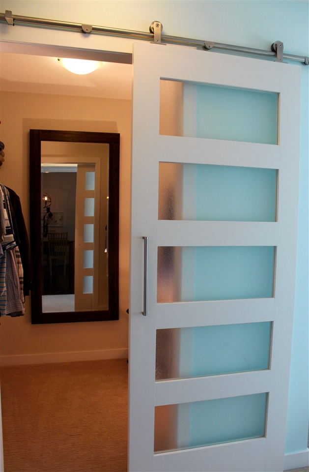 Thoughtfully upgraded walk in master closet with custom barn door - looks great!