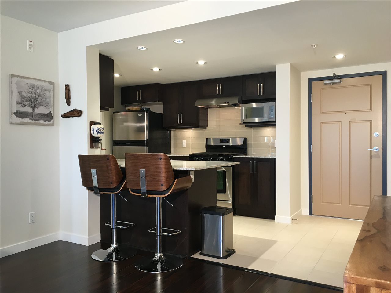 Sensible tile in entry and kitchen laundry. Social eating Bar is a perfect spot to perch!