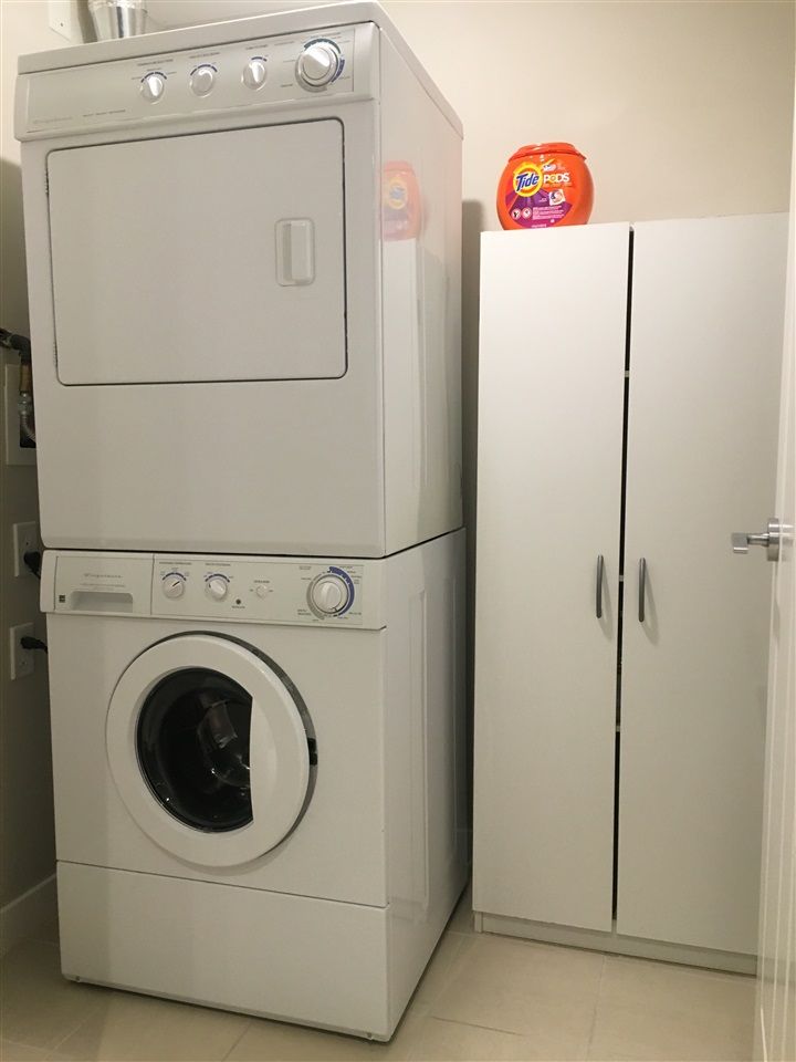Great space adjacent to kitchen for laundry and extra storage.