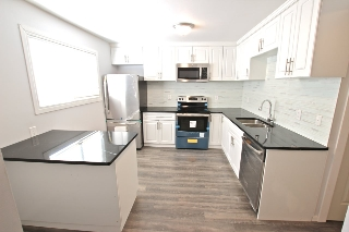 Main Photo: 1338 LAKEWOOD Road W in Edmonton: Zone 29 Townhouse for sale : MLS(r) # E4052180