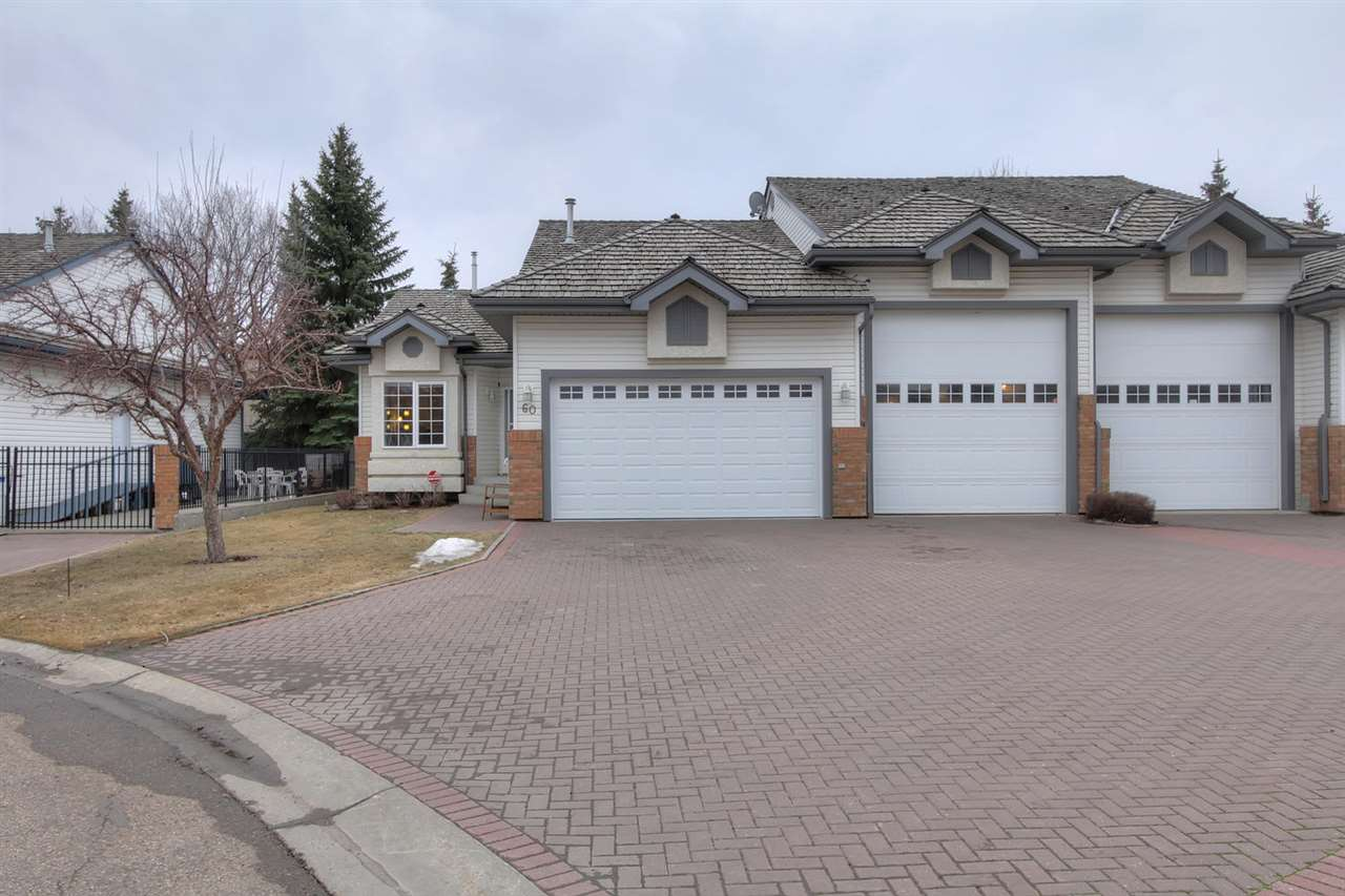 This sweeping driveway leads to both the home entry, the double attached garage and the HUGE R.V. garage... and still leaves space for vehicles in front of the garages.