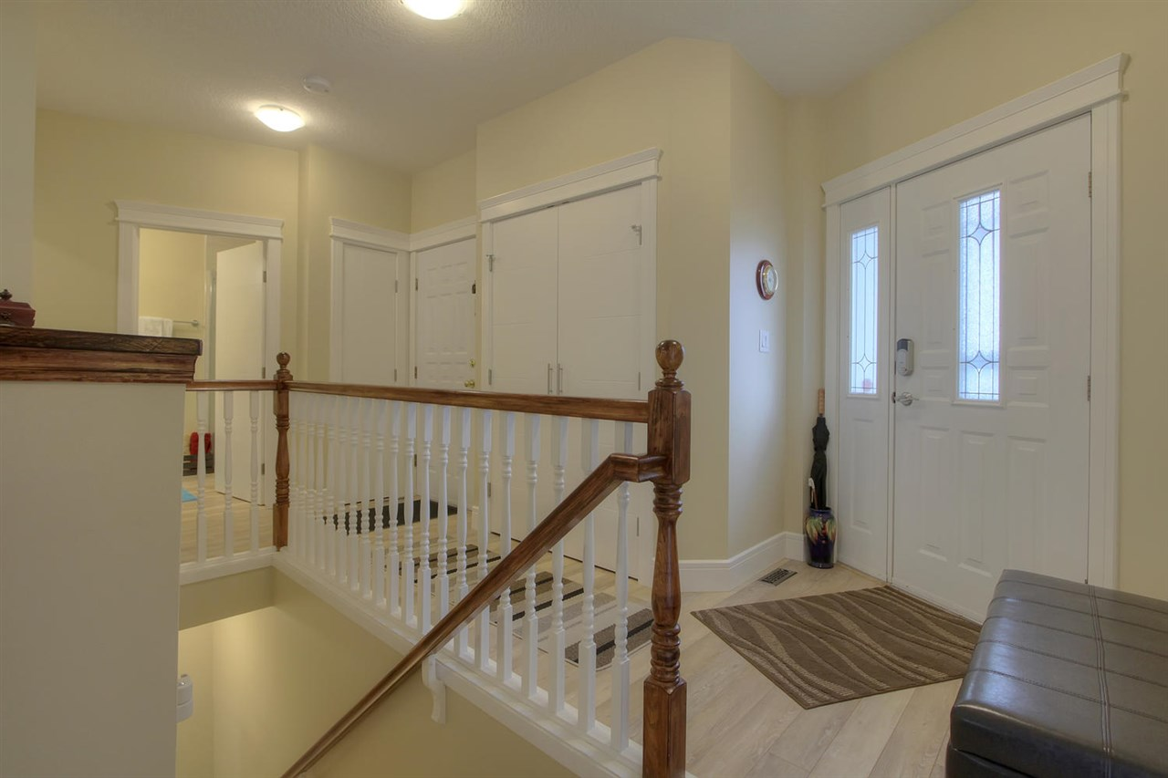 This space at the entranceway is lovely and welcoming. There is space for a bench and the small hallway leads to the main bathroom, the garage entranceways and the master bedroom.