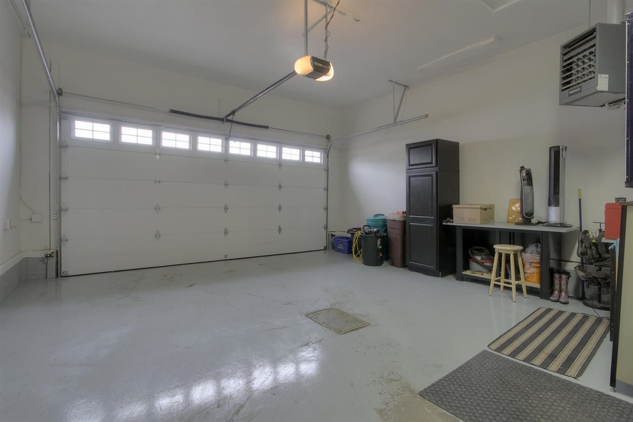 The double attached garage has a door that leads into the R.V. garage. This one is fully finished and has a heater. The warmth extends to the RV garage if you leave the door open between them.