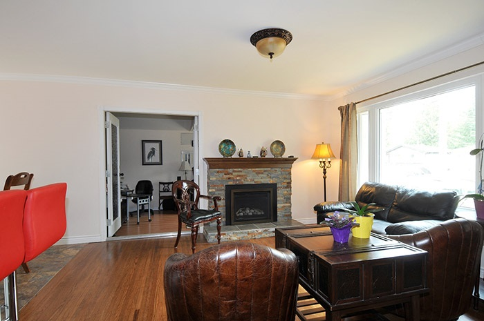 Very open with gas fireplace and French doors to the family room