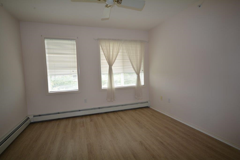 Lots of natural light in this front bedroom would make it great for a craft room or den.