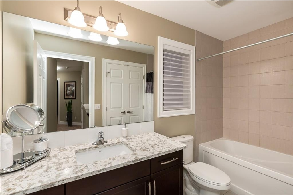 Main bathroom with extra linen storage closet!