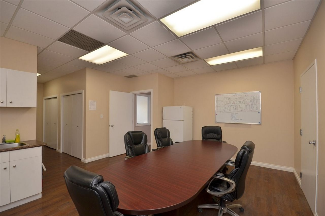 EXTRA LARGE BOARDROOM TABLE FITS IN AREA ADJACENT TO KITCHEN. IDEAL FOR MEETINGS.