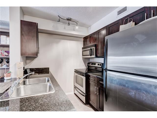 Photo 11: 114 7210 80 Avenue NE in Calgary: Saddle Ridge Condo for sale : MLS(r) # C4107512