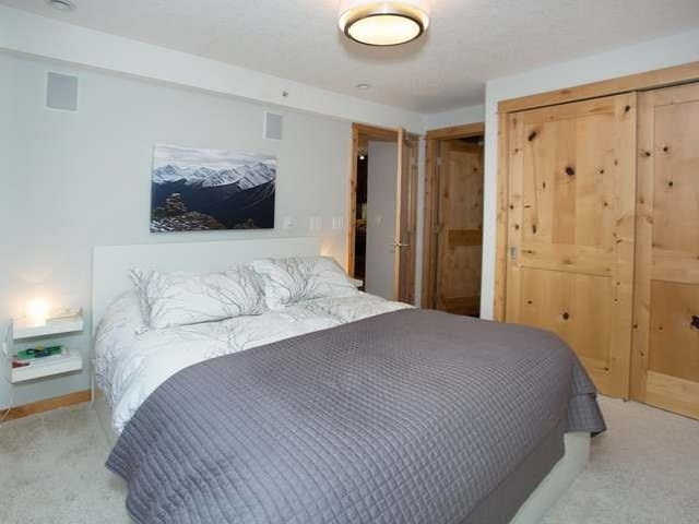 Photo 9: 304 2100A Stewart Creek Drive: Canmore Condo for sale : MLS(r) # C4113209