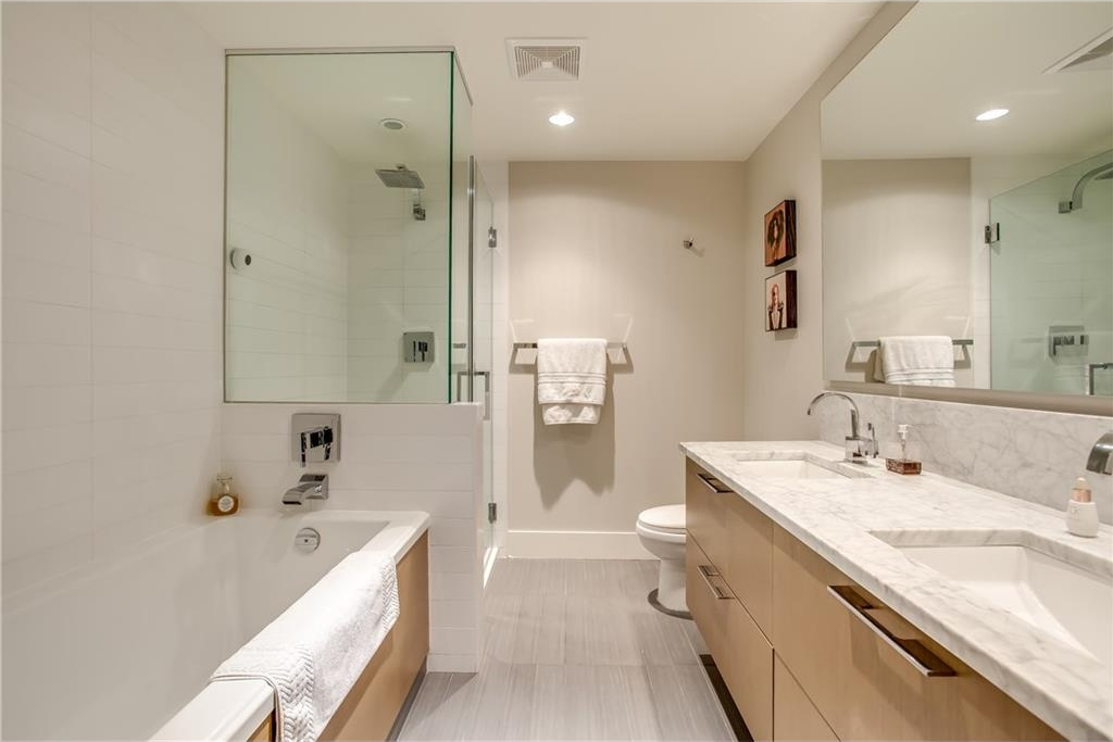 5 pc ensuite oasis with extra deep soaker tub, heated floors, 10mm glass shower and dual granite vanity.