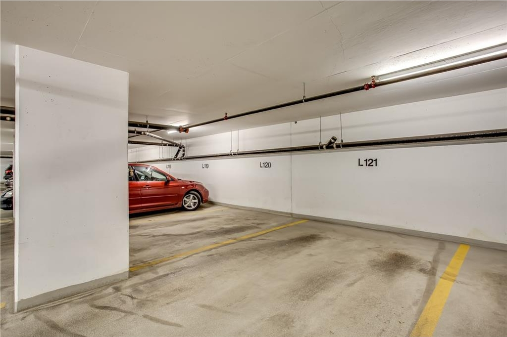 Parking stall is extra wide with easy access to the elevators.
