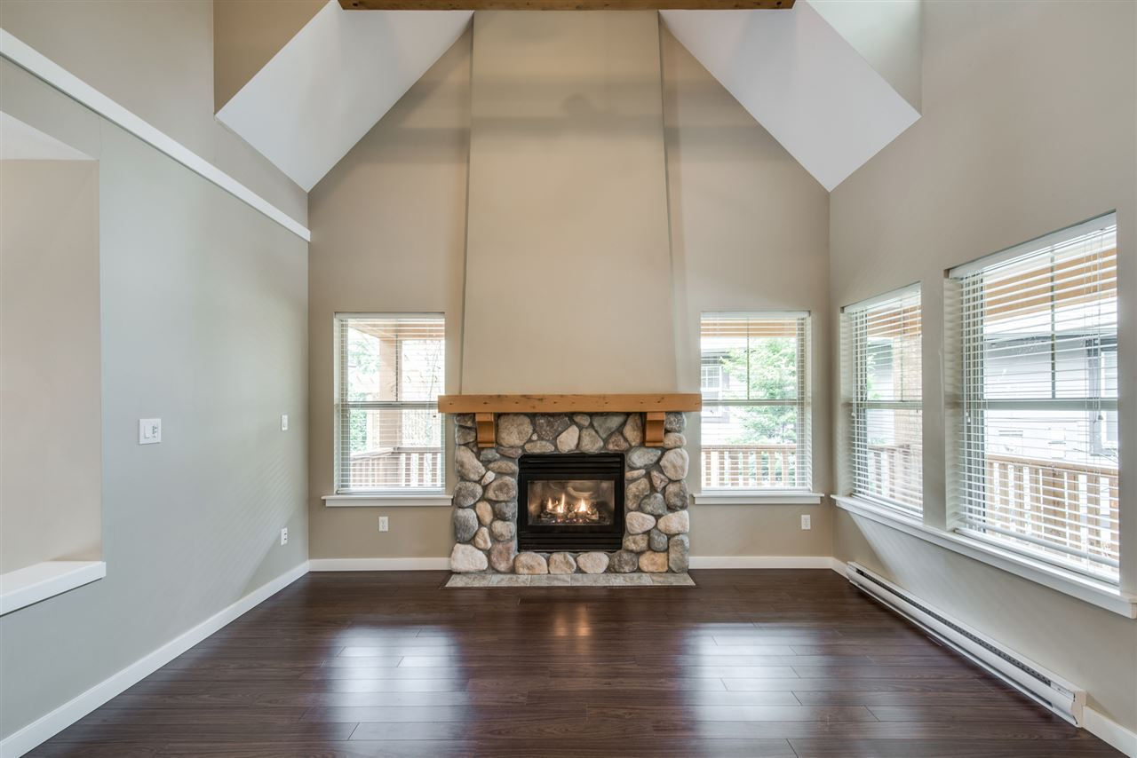 Vaulted ceilings and stone fireplace mantel