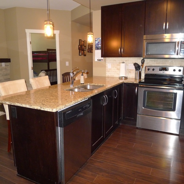 Kitchen with granite counter tops and stainless steel appliances!!