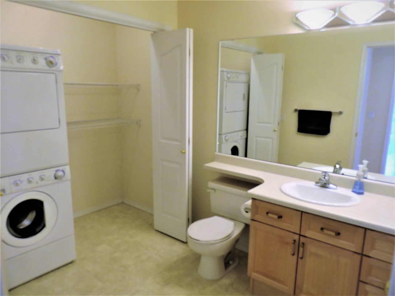 Here is the main 3pc Bathroom/Laundry Room located next to the 2nd Bedroom! :)