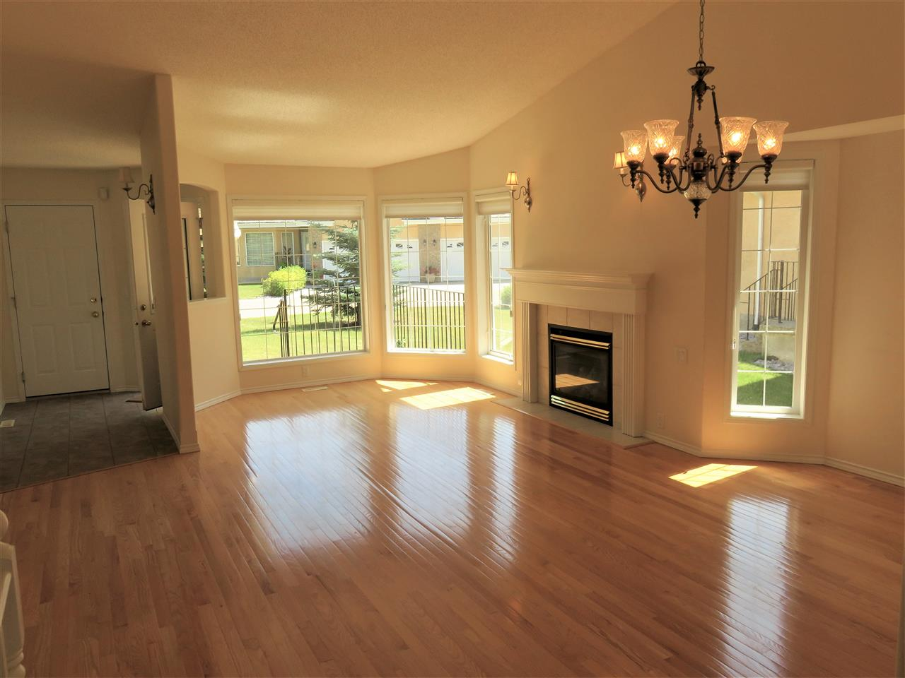 Here is a full view of both the Living Room & Formal Dining Room! Note the beautiful HARDWOOD & VAULTED CEILINGS TOO! :)