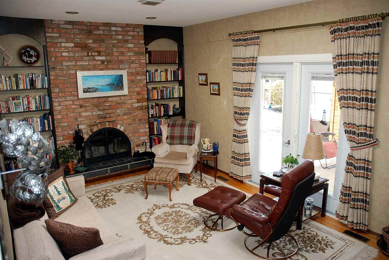 Spacious family room with french doors access to partially covered deck.