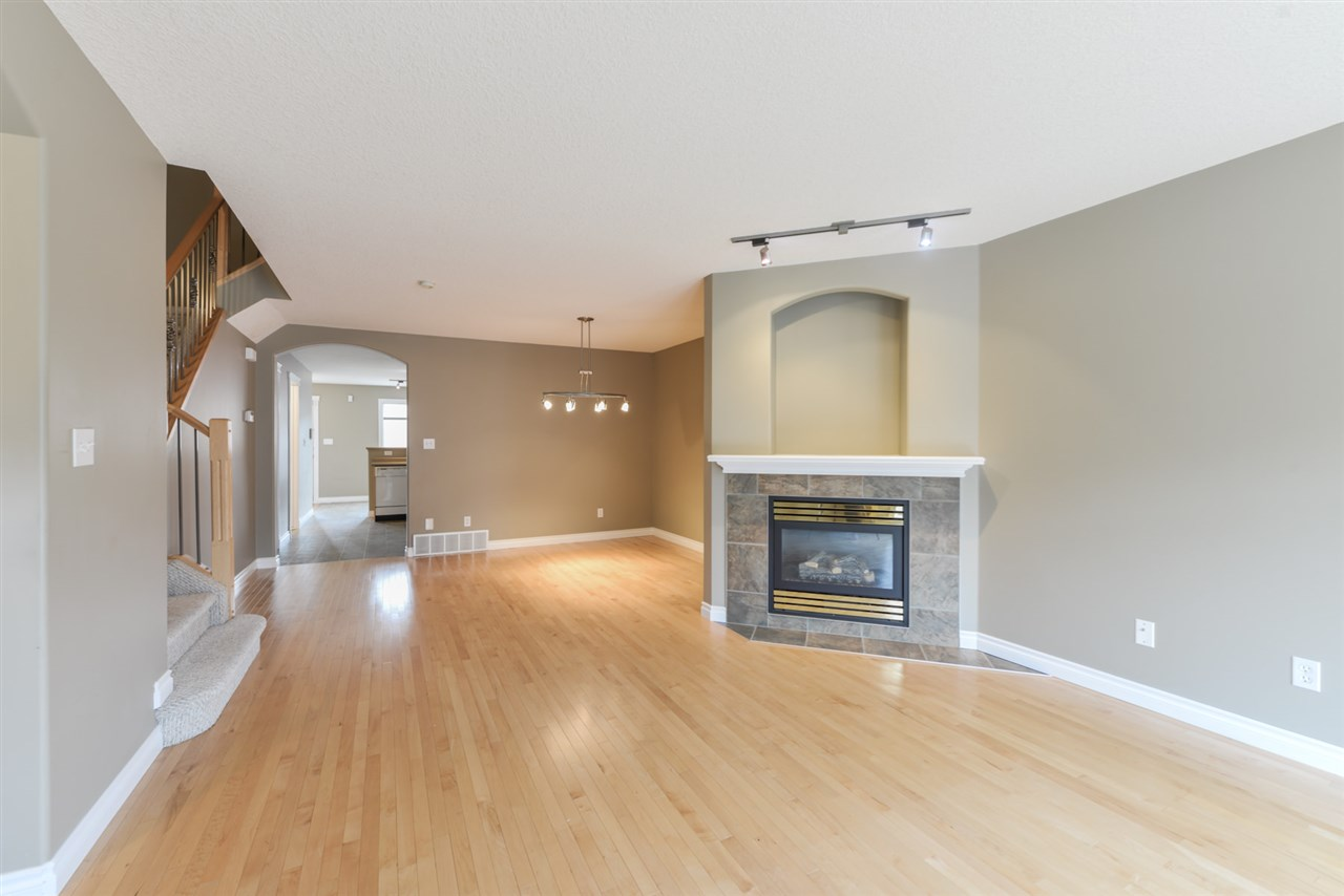 Featuring gas fireplace and hardwood flooring.