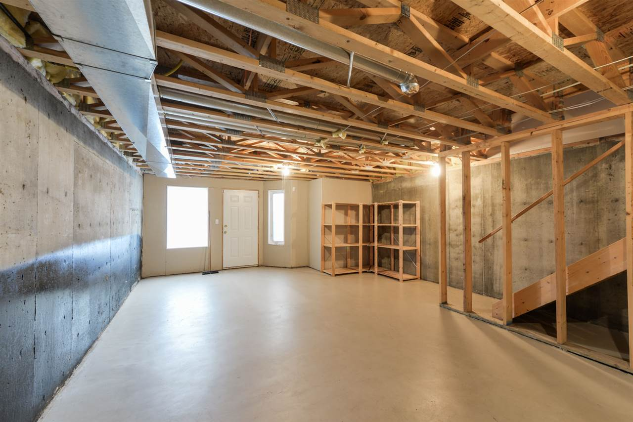 Unfinished basement with walk-out entrance. Perfect for home office!