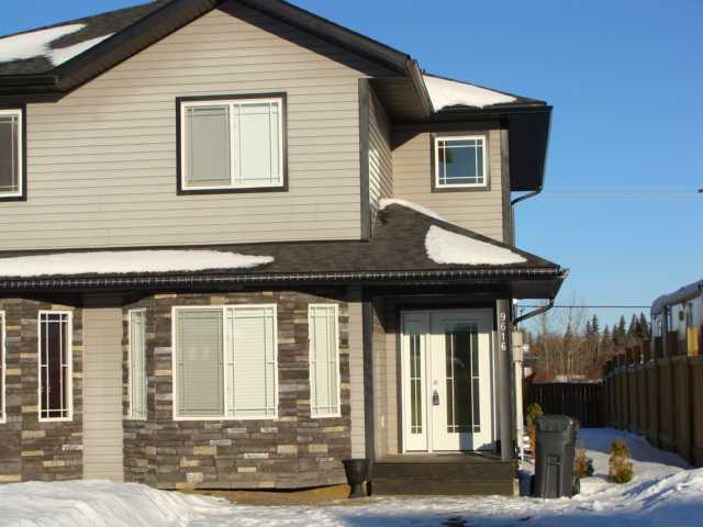 "Main Photo: 9616 118TH Avenue in Fort St. John: Fort St. John - City NE House 1/2 Duplex for sale in ""EVERGREEN ESTATES"" (Fort St. John (Zone 60))  : MLS® # N232393"