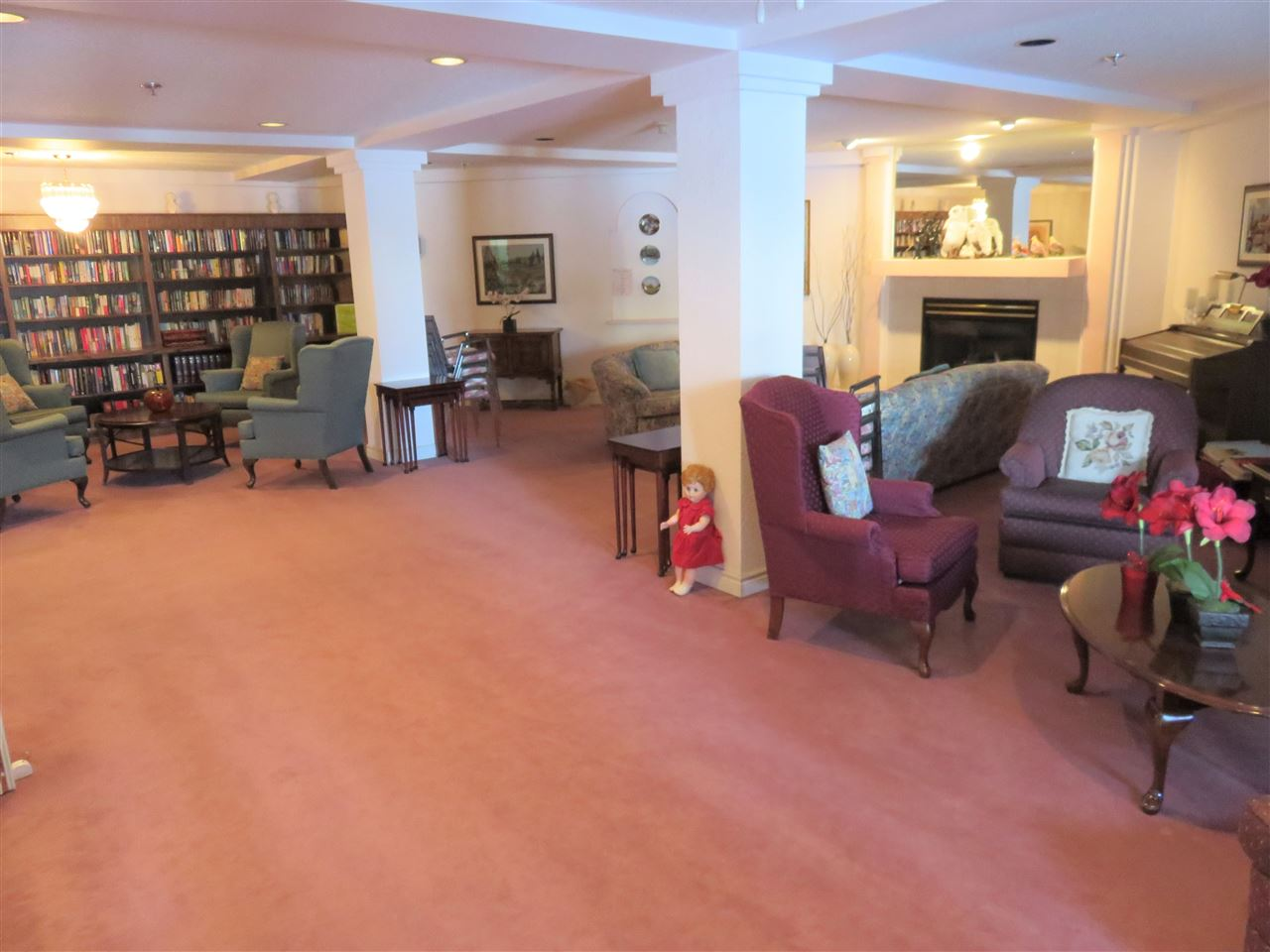 View of the main floor Library! Note the gas fireplace for you to sit & relax!...