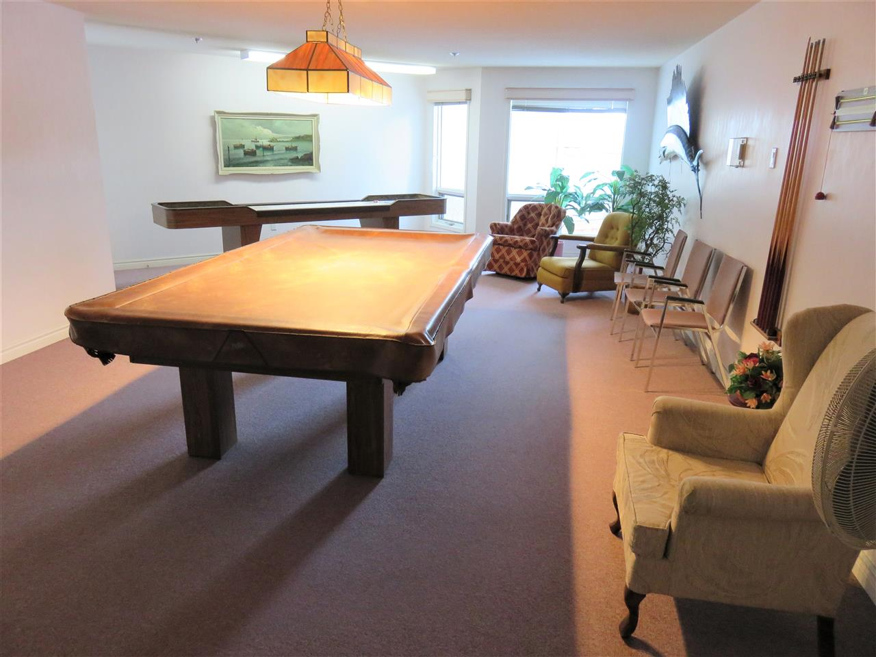 View of the 3rd Floor games room w/a pool table & shuffle board!