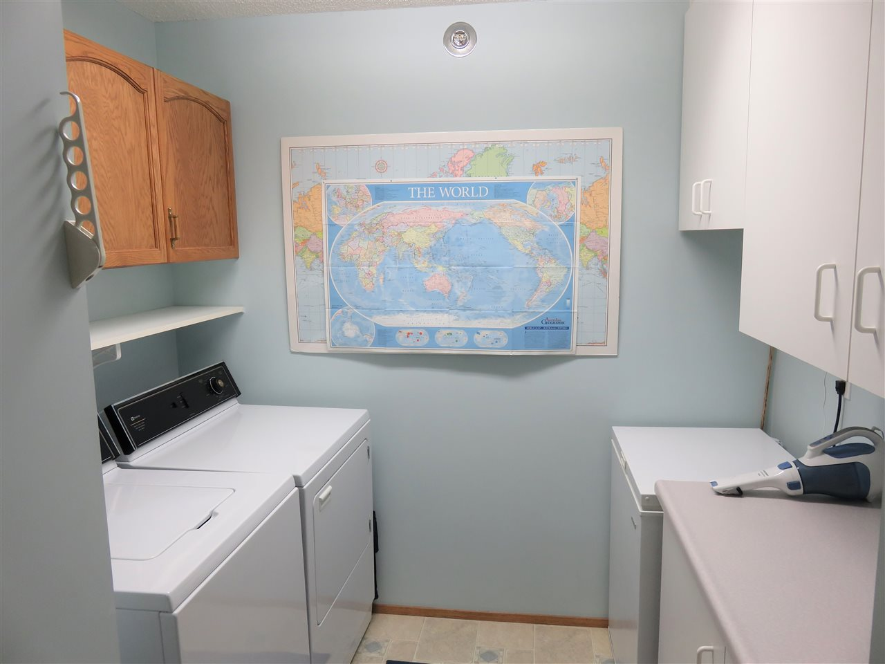 Here is your large Laundry Room located at your door into the unit! Note all the cupboard space! Also the BI. Vacuum System is located in the cupboard to the right of the picture! :)