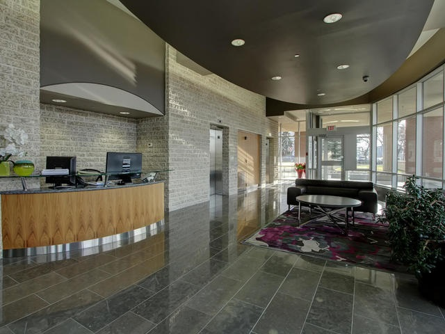 Main lobby area with Concierge Desk offering private elevator to suites and public elevator.