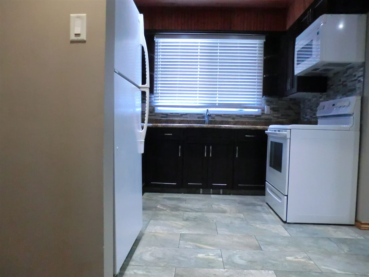 Kitchen upgraded and entire main floor remodelled in 2013.