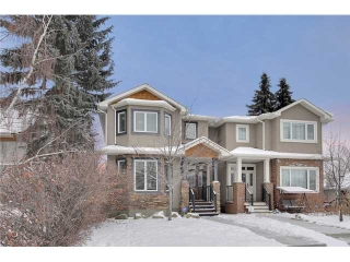 Main Photo: 212 25 Avenue NW in Calgary: Tuxedo Residential Attached for sale : MLS® # C3651686