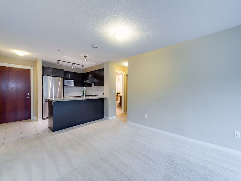 "Photo 2: 102 9199 TOMICKI Avenue in Richmond: West Cambie Condo for sale in ""MERIDIAN GATE"" : MLS(r) # R2006928"