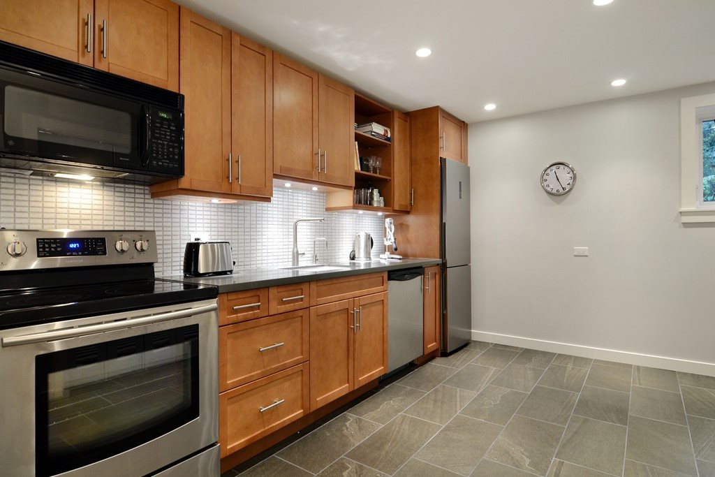 heated floor, laundry and stainless steel appliances